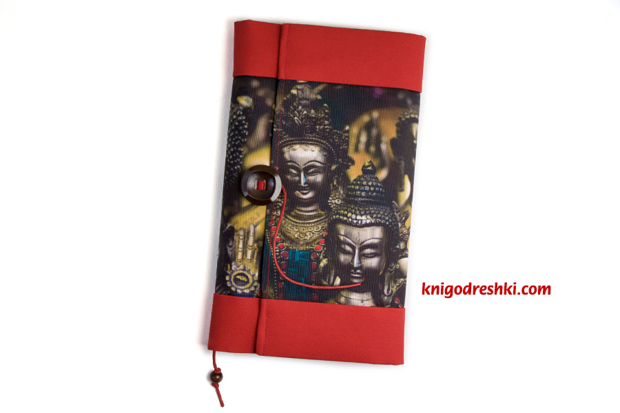 book sleeve witn an image of buddha statues