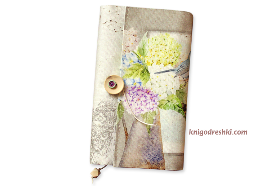 book sleeve with an image of a bird and hortensias