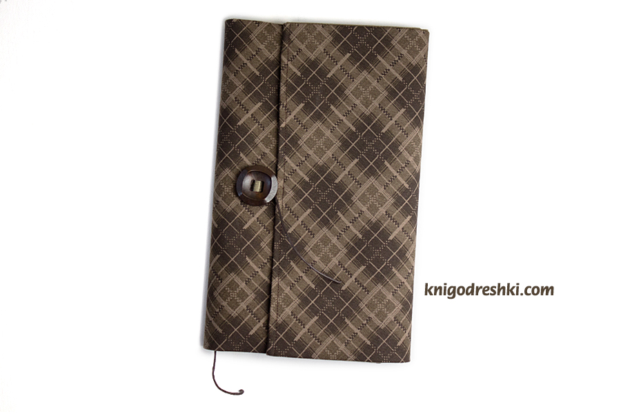book sleeve with a brown tartan pattern